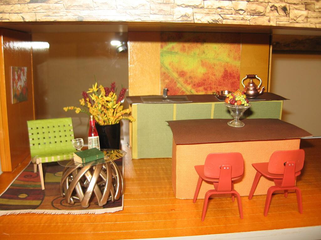 фисташковый цвет в оранжевом интерьере кухни